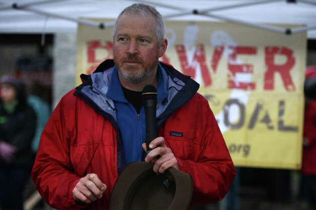 Seattle Mayor Mike McGinn speaks during a protest against proposed coal trains that would pass through Seattle on Sunday, February 17, 2013 at Seattle's Golden Gardens Park.