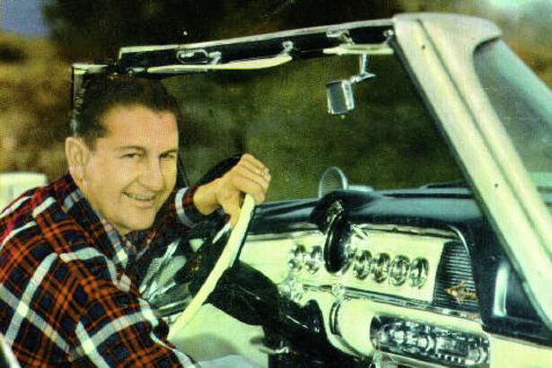 Lawrence Welk demonstrates the Highway Hi-Fi in a 1956 Dodge