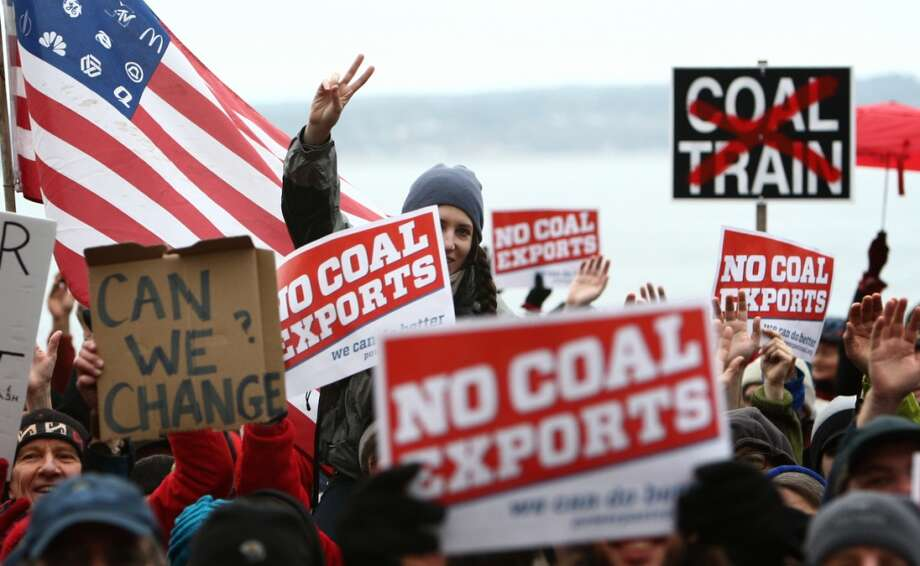 People gather during a protest against proposed coal trains that would pass through Seattle on Sunday, February 17, 2013 at Seattle's Golden Garden's Park. The trains are part of a proposal to ship coal from the U.S. via rail to ships and eventually to Asia. Opposition to the plan has been fierce, especially in Western Washington.