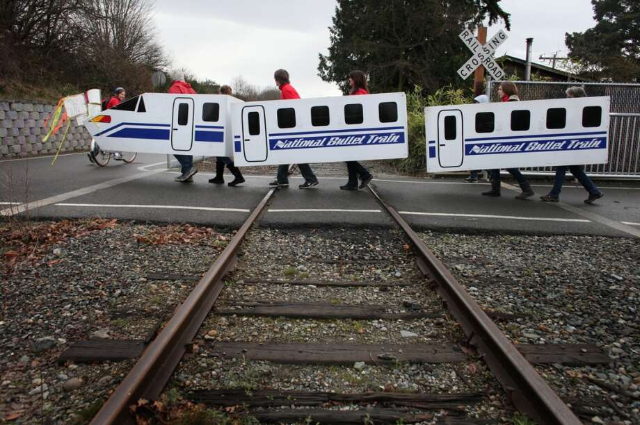 A protest prop crosses railroad tracks during a protest against proposed coal trains that would pass through Seattle. The trains are part of a proposal to ship coal from the U.S. via rail to ships and eventually to Asia. Opposition to the plan has been fierce, especially in Western Washington.