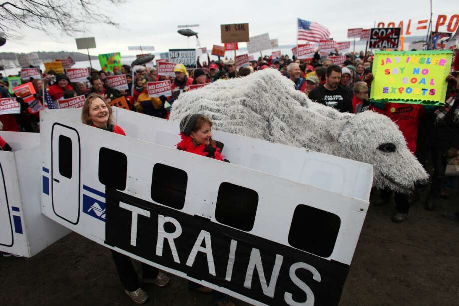 People gather during a protest against proposed coal trains that would pass through Seattle.
