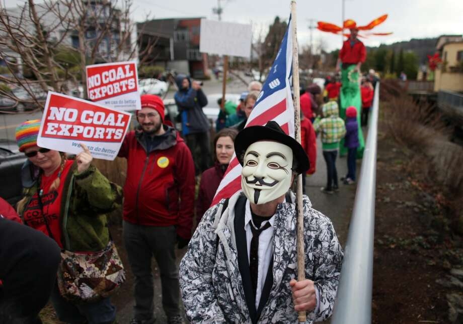 People march during a protest against proposed coal trains that would pass through Seattle. The trains are part of a proposal to ship coal from the U.S. via rail to ships and eventually to Asia. Opposition to the plan has been fierce, especially in Western Washington.