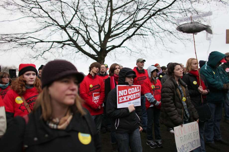 People gather during a protest against proposed coal trains that would pass through Seattle at Seattle's Golden Garden's Park. The trains are part of a proposal to ship coal from the U.S. via rail to ships and eventually to Asia. Opposition to the plan has been fierce, especially in Western Washington.