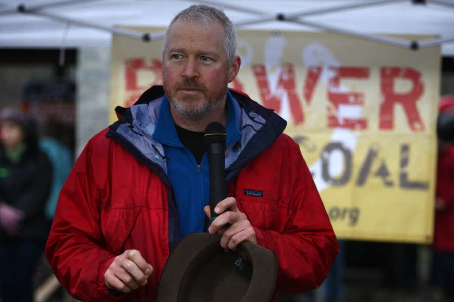 Seattle Mayor Mike McGinn speaks during a protest against proposed coal trains at Seattle's Golden Garden's Park.