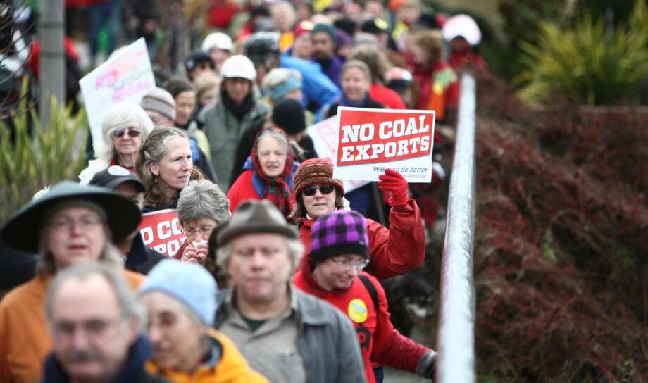 People march during a protest against proposed coal trains that would pass through Seattle.