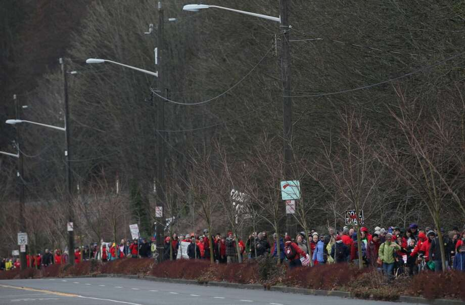 People march along the Burke-GIlman Trail during a protest against proposed coal trains.