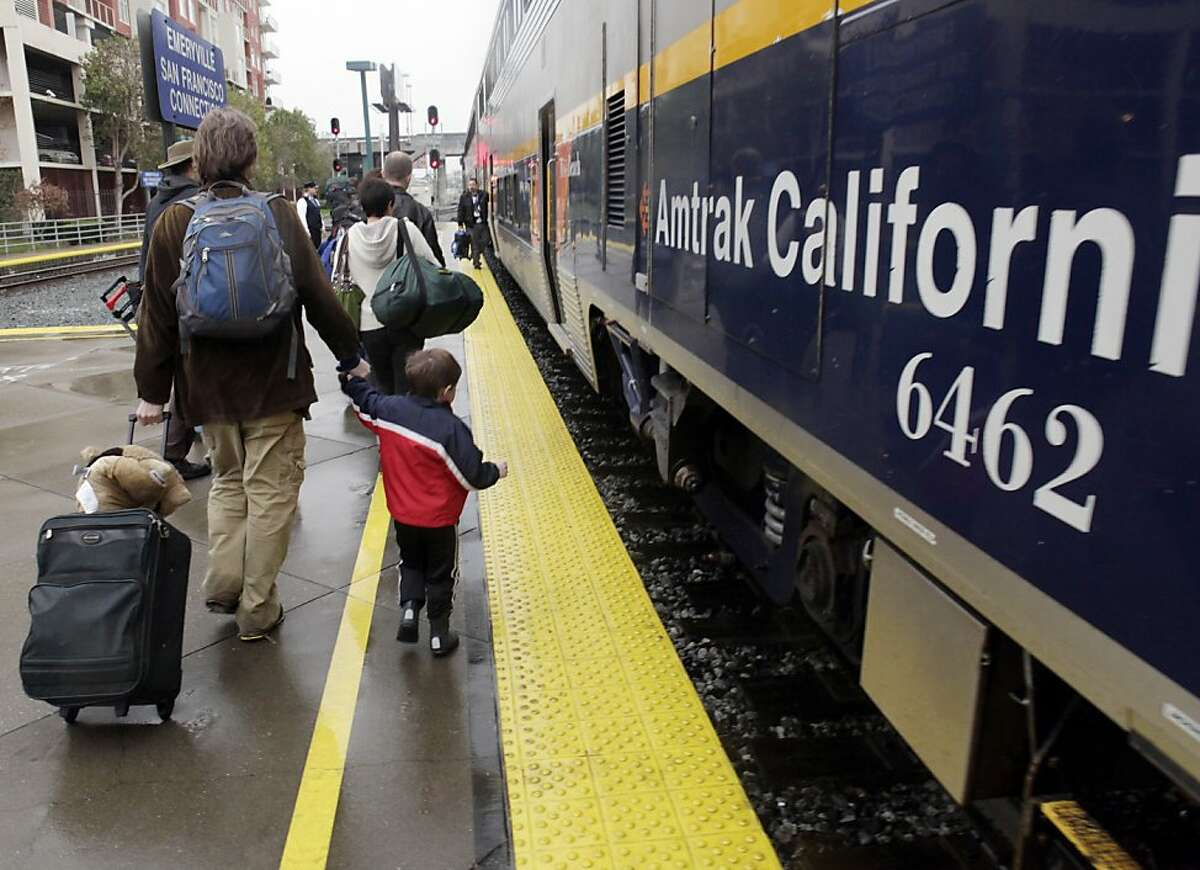 Barton Saunders and his son, Hayden Saunders, 3, of Los Angeles, prepare to board the Capitol Corridor Amtrak train at the Emeryville, Calif., station on Tuesday, December 28, 2010. While high-speed rail in California is getting all the attention, the state's lower-speed intercity trains are seeing a boom in popularity. Trains like the Capitol Corridor, shown here on Thursday, December 23, 2010, in Emeryville, Calif., have seen a double digit rise in passengers.