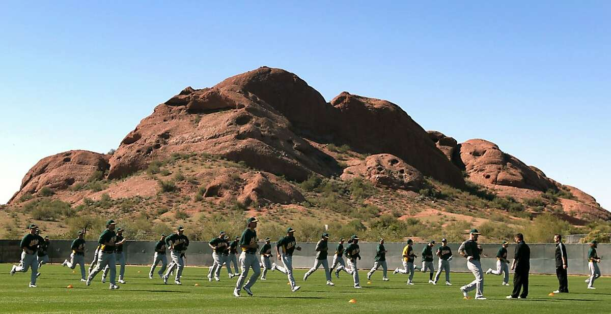 The Oakland Athletics' workout during spring training Saturday, Feb. 16, 2013, in Phoenix, Ariz.