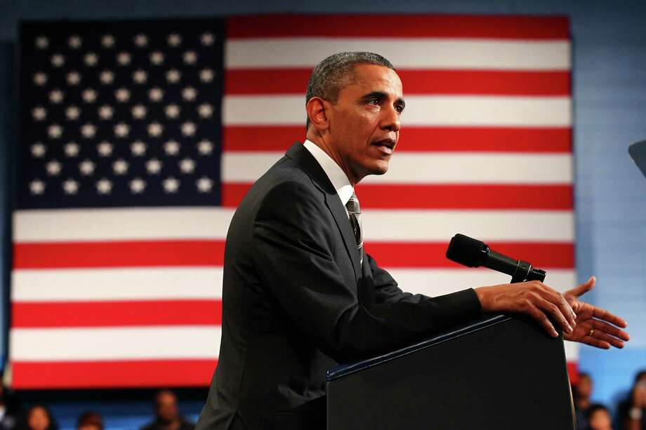 President Barack Obama has called for an increase in the U.S. minimum wage, a move that would help Texas. Photo: Zbigniew Bzdake, Chicago Tribune / Chicago Tribune