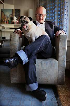 Interior designer and NWBLK founder Steven Miller showing some favorite things at home in San Francisco, Calif., including one of his dogs Dash and a Phase design swivel chair on Friday, January 18, 2013.