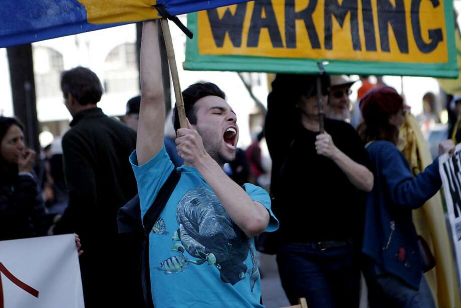 Michael Zambano chants against the pipeline that would bring oil from tar sands in Canada. Photo: Jessica Olthof, The Chronicle