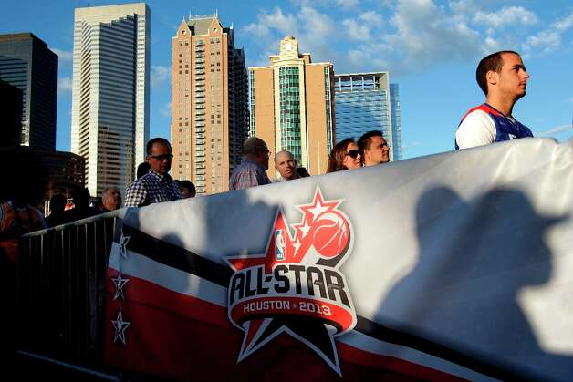 Fans wait for the gates to open before the NBA All-Star Game at the Toyota Center on Sunday. Photo: Melissa Phillip / © 2013  Houston Chronicle
