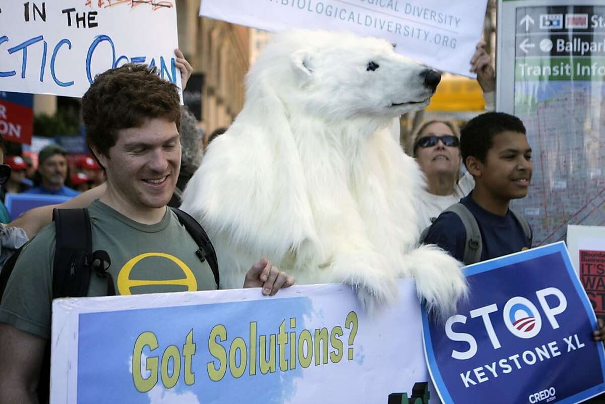 Representatives of Center for Biological Diversity stand with a polar bear on February 17th, 2013 in San Francisco, Calif. The protest began at the State Department building and concentrated on issues over the Keystone pipeline and other problems surrounding climate change. Dozens of organizations like the Sierra Club, Greenpeace, NRDC sponsored The Forward on Climate rally. More than 2,000 people participated in this event.