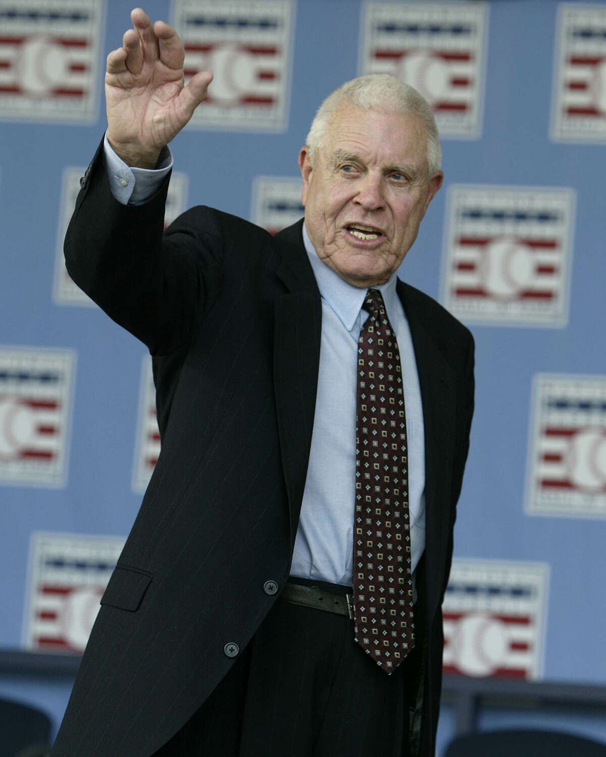 Broadcaster Lon Simmons, the longtime voice of baseball in the San Francisco Bay area, waves at the end of the 2004 National Baseball Hall of Fame induction ceremonies Sunday, July 25, 2004 in Cooperstown, N.Y. Simmons is the recipient of the Ford C. Frick Award given annually to a baseball broadcaster. (AP Photo/John Dunn) Ran on: 07-26-2004 Photo caption Dummy text goes here. Dummy text goes here. Dummy text goes here. Dummy text goes here. Dummy text goes here. Dummy text goes here.Dummy text goes here. Dummy text goes here. Ran on: 07-26-2004 ProductNameChronicle