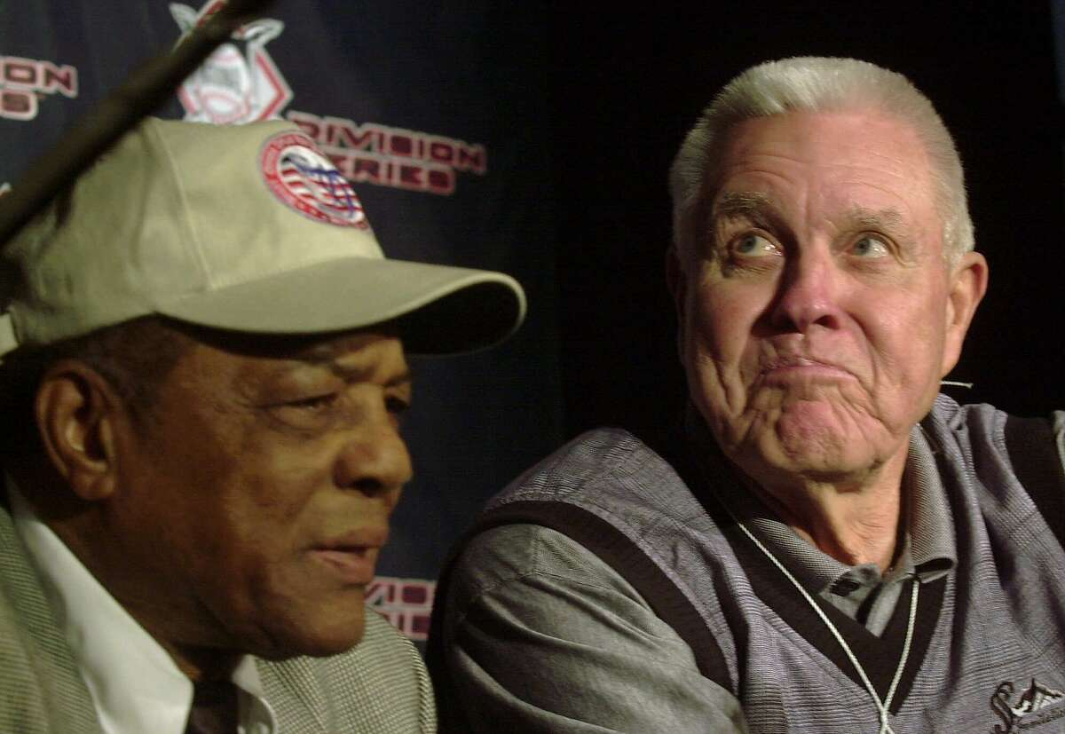 Lon Simmons, right, listens to friends talk about his broadcasting career as he sits next to Willie Mays, left, at Pacific Bell Park in San Francisco, Thursday, Oct. 5, 2000. The broadcasting booth at the new ballpark was named the Hodges-Simmons Broadcast Center after Simmons and fellow San Francisco Giants broadcaster Russ Hodges. (AP Photo/Dan Krauss)