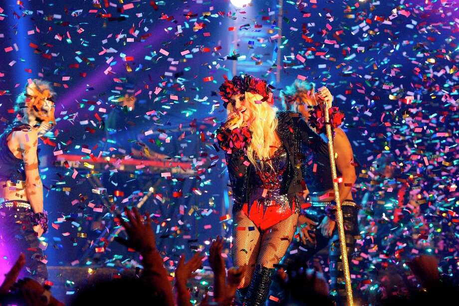 Confetti falls as Ke$sha performs during the Sprint NBA All-Star Pregame Concert at the George R. Brown Convention Center on Sunday. Photo: Cody Duty / © 2013  Houston Chronicle