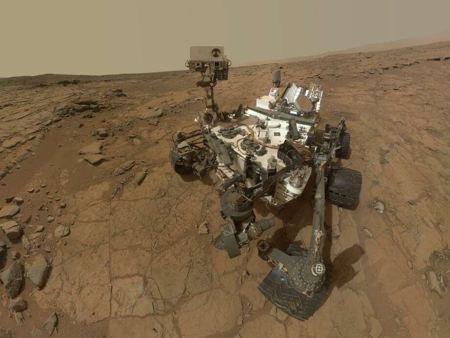 Now, of course, we still use robots to go where no man can yet go.This rectangular version of a self-portrait of NASA's Mars rover Curiosity combines dozens of exposures taken by the rover's Mars Hand Lens Imager (MAHLI) during the 177th Martian day, or sol, of Curiosity's work on Mars (Feb. 3, 2013).  Photo: NASA