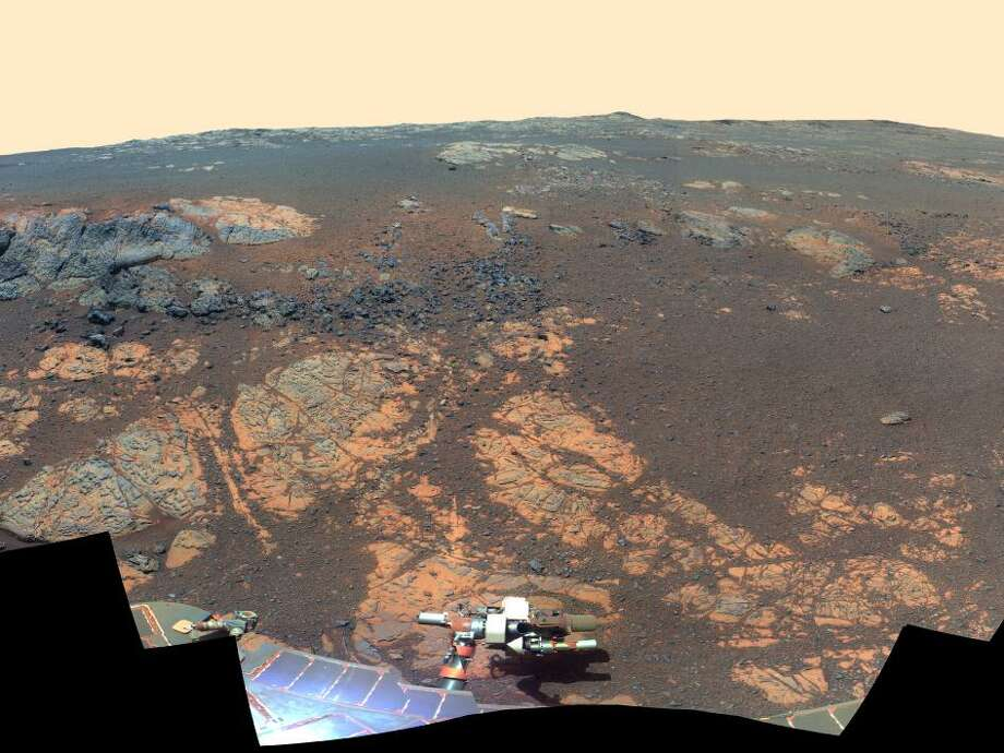 As NASA's Mars Exploration Rover Opportunity neared the ninth anniversary of its landing on Mars, the rover was working in the 'Matijevic Hill' area seen in this view from Opportunity's panoramic camera (Pancam). Opportunity landed Jan. 24, 2004, PST (Jan. 25 UTC). The landing site was about 12 miles (19 kilometers), straight-line distance, or about 22 miles (35.5 kilometers) driving-route distance, from this location on the western rim of Endeavour Crater. 