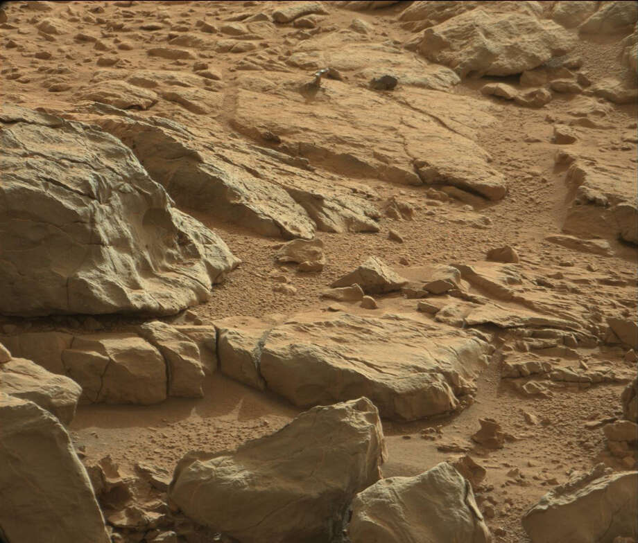 On Mars, as on Earth, sometimes things can take on an unusual appearance. A case in point is a shiny-looking rock seen in a recent image from NASA's Curiosity Mars rover. Can you find what caused all the hubbub? Photo: NASA