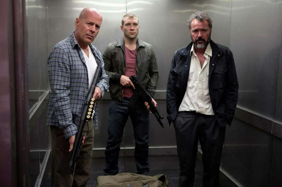 "FILE - This publicity film image released by 20th Century Fox shows Bruce Willis as John McClane, left, Jai Courtney as his son Jack, center and Sebastian Koch as Komarov in a scene from ""A Good Day to Die Hard."" (AP Photo/20th Century Fox, Frank Masi, File) Photo: Frank Masi"