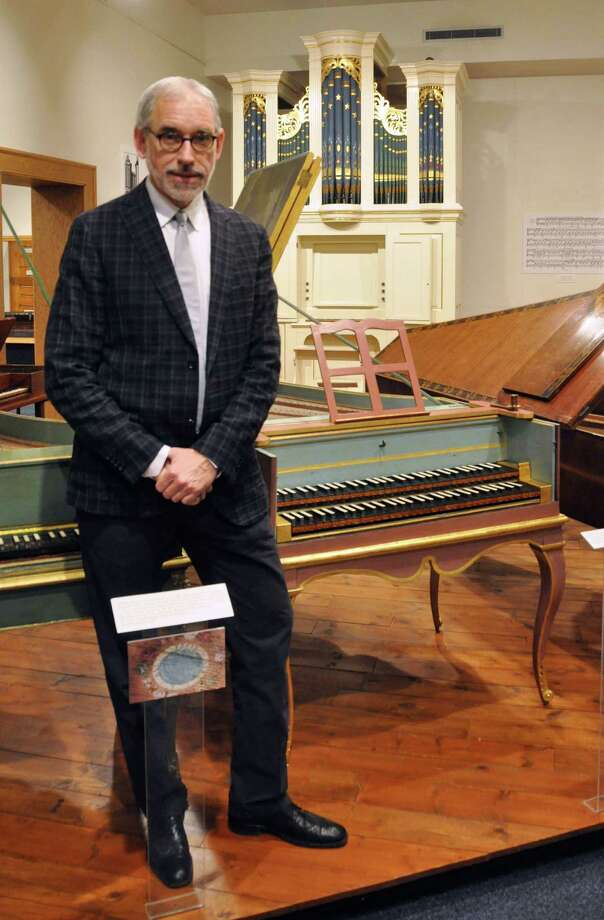 Cleveland Johnson, new director of the National Music Museum, stands in front of some historic keyboard instruments in the museum's Abell Gallery, Thursday, Jan. 10, 2013, in Vermillion, S.D. The museum is embarking upon a $15 million expansion to better showcase its more than 15,000 instruments. (AP Photo/Dirk Lammers) Photo: DIRK LAMMERS