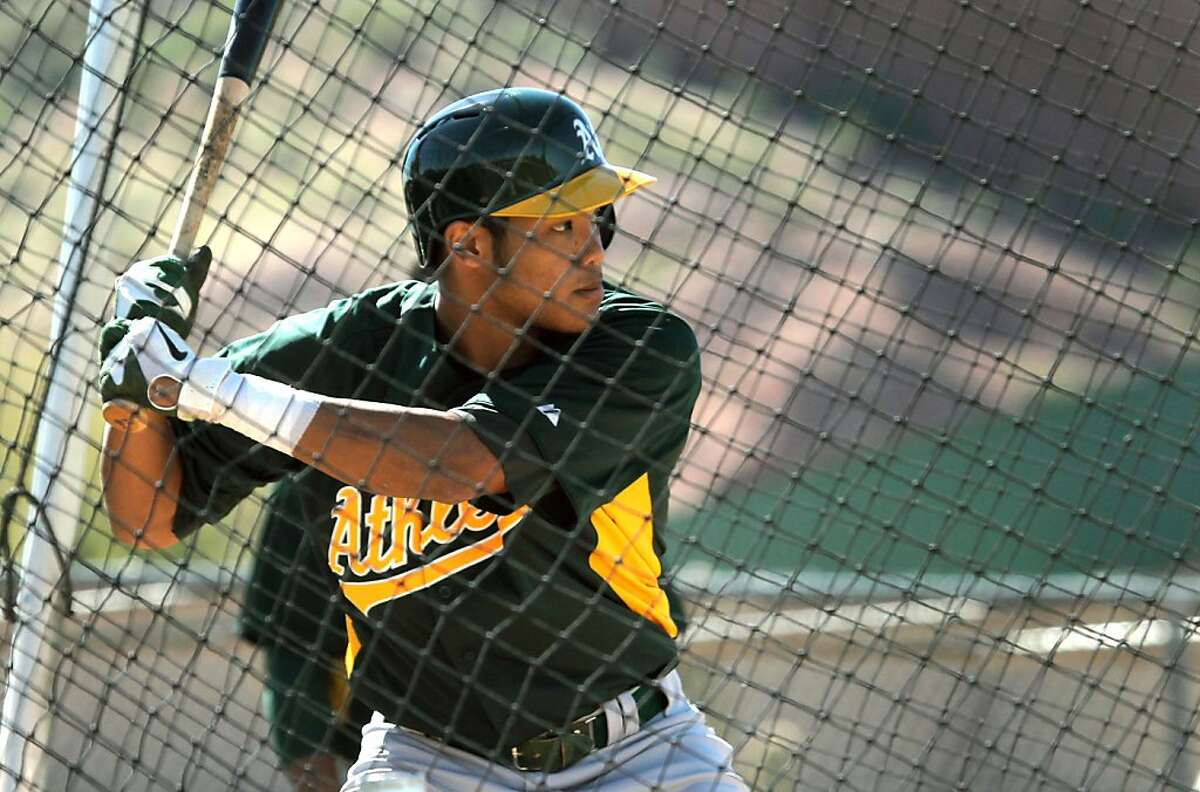 Oakland Athletics' Addison Russell 19, the youngest player attending spring training in the country takes batting practice at spring training Saturday, Feb. 16, 2013, in Phoenix, Ariz.