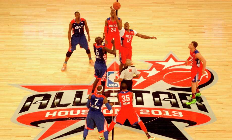 Dwight Howard of the Los Angeles Lakers (12) wins the opening tipoff of the NBA All-Star Game from Kevin Garnett of the Boston Celtics (5) at the Toyota Center on Sunday. Photo: Melissa Phillip / © 2013  Houston Chronicle
