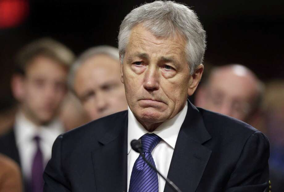Defense secretary nominee Chuck Hagel probably will have enough votes to be confirmed, Sen. John McCain said. Photo: J. Scott Applewhite / Associated Press