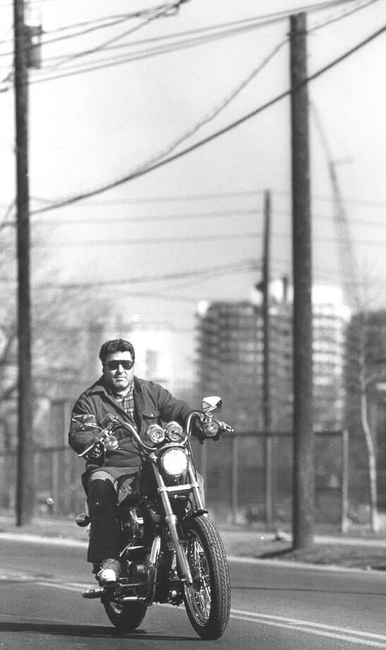 With temperatures in the high 40s, Nick Pisanelli takes his new Harley Davidson out for the first time on Feb. 18, 1988. But first, he had to push it to a cycle shop to get it started. Photo: Advocate