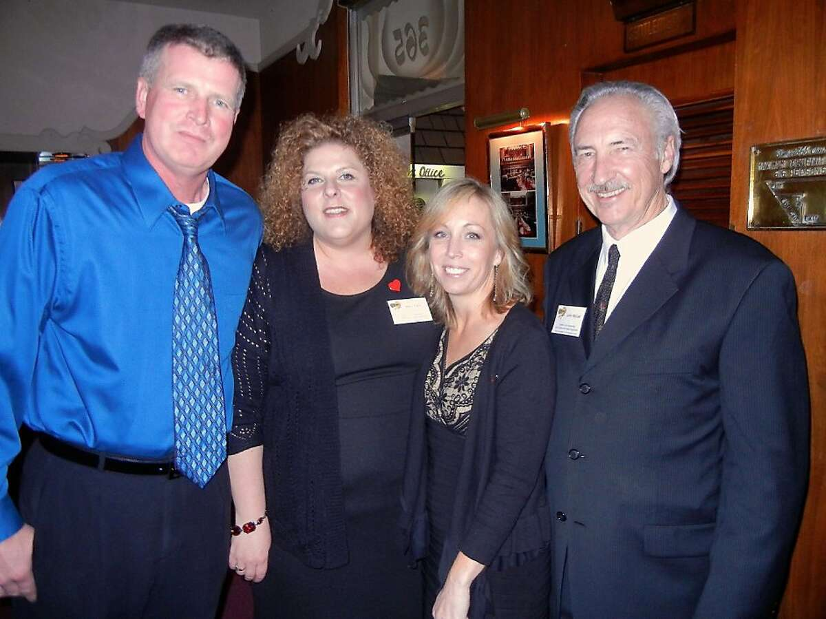 That's Amore co-chairs (from left) Eddie and Mary Flynn and Beth Fergus with Pomeroy Center CEO John McCue at Bimbo's 365 Club. Feb. 2013. By Catherine Bigelow.