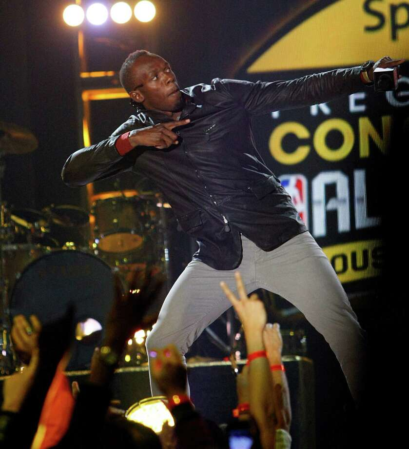 Olympic gold medalist sprinter Usain Bolt plays to the crowd during the Sprint NBA All-Star Pregame Concert at the George R. Brown Convention Center on Sunday, Feb. 17, 2013, in Houston. Photo: Cody Duty, Houston Chronicle / © 2013  Houston Chronicle