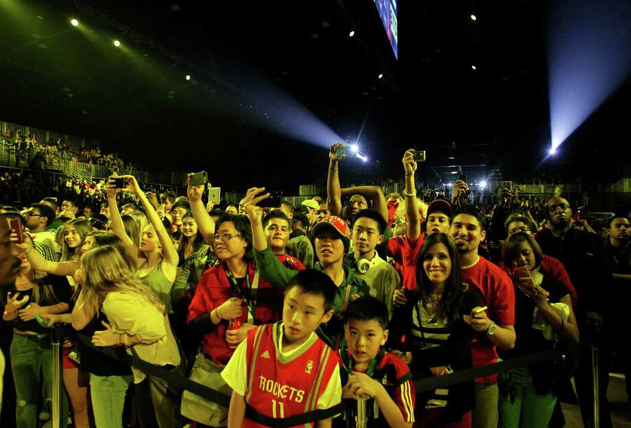 Fans push toward the stage to see the Sprint NBA All-Star Pregame Concert at the George R. Brown Convention Center on Sunday, Feb. 17, 2013, in Houston. Photo: Cody Duty, Houston Chronicle / © 2013  Houston Chronicle