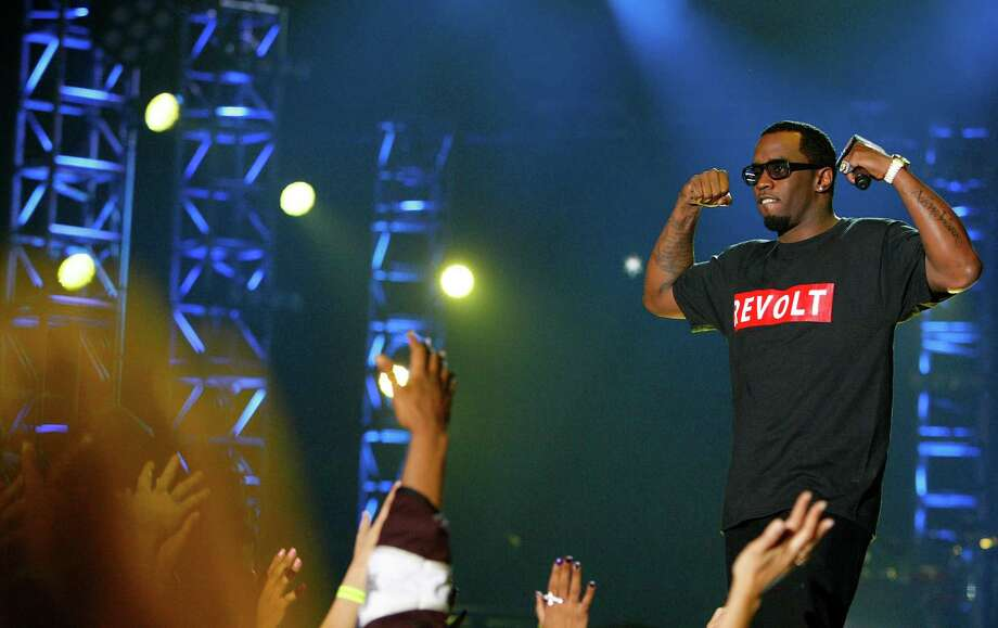 Sean Combs flexes for the crowd during the Sprint NBA All-Star Pregame Concert at the George R. Brown Convention Center on Sunday, Feb. 17, 2013, in Houston. Photo: Cody Duty, Houston Chronicle / © 2013  Houston Chronicle