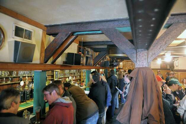 Customers fill the inside at Mahar's Public Bar  on the last day the bar is open on Sunday, Feb. 17, 2013 in Albany, NY.  The building were Mahar's is located was purchased and the new owners plan to open another bar at the location.  (Paul Buckowski / Times Union) Photo: Paul Buckowski  / 00021147A