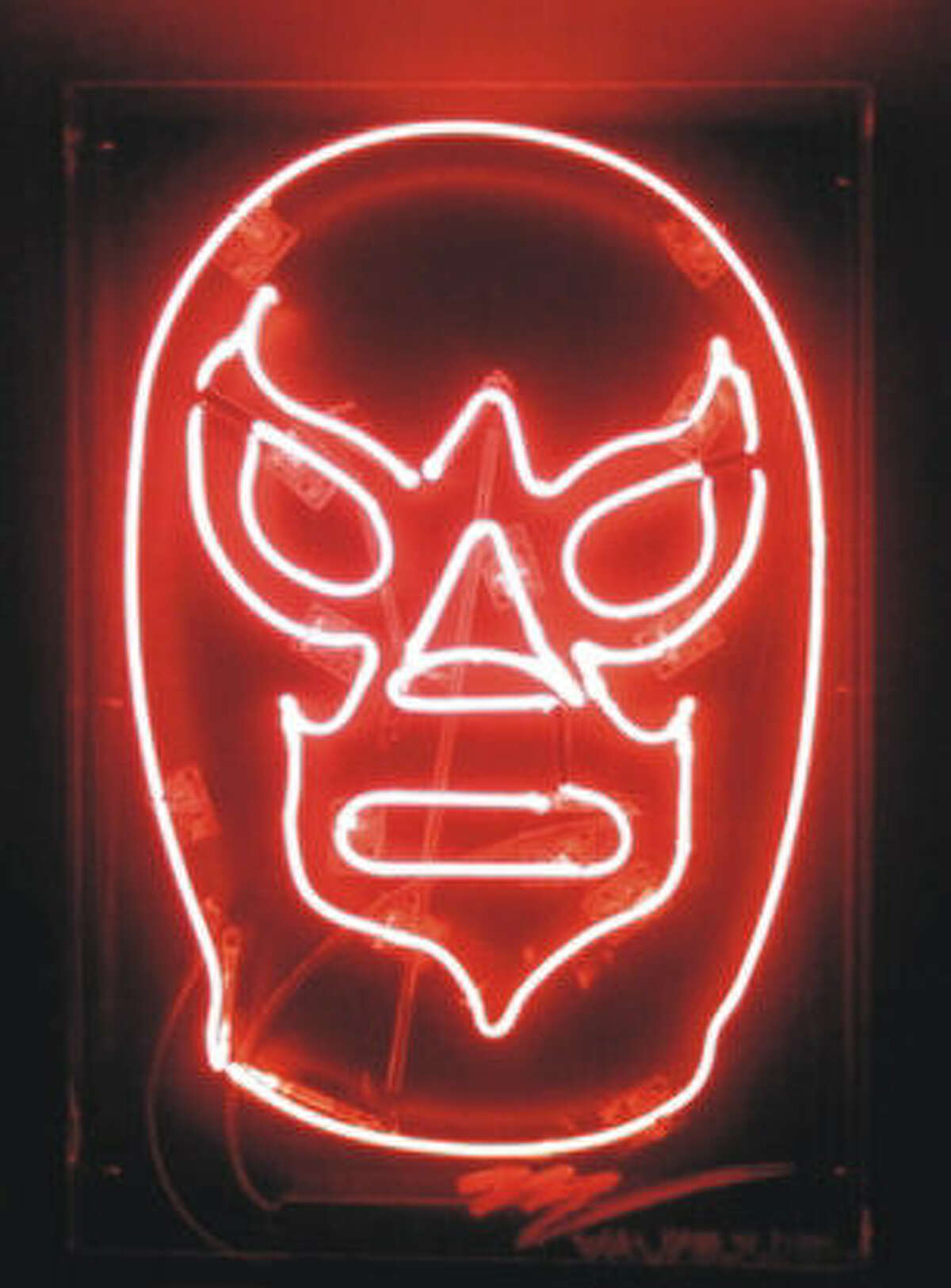 """Miguel Valverde's """"Hagase la Lucha"""" is a neon sculpture of a Mexican wrestler's mask featured in Arte Chihuahua."""