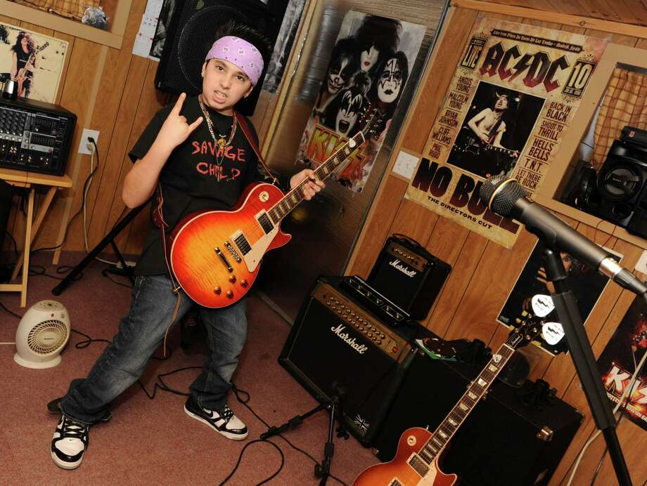 Heavy metal riffing guitar prodigy Joe Pettinato, 13, plays his guitar in his room at his home on Thursday Feb. 14, 2013 in Colonie, N.Y. Joe has Tourette's and left Sand Creek Middle School last week because of the bullying. (Lori Van Buren / Times Union) Photo: Lori Van Buren