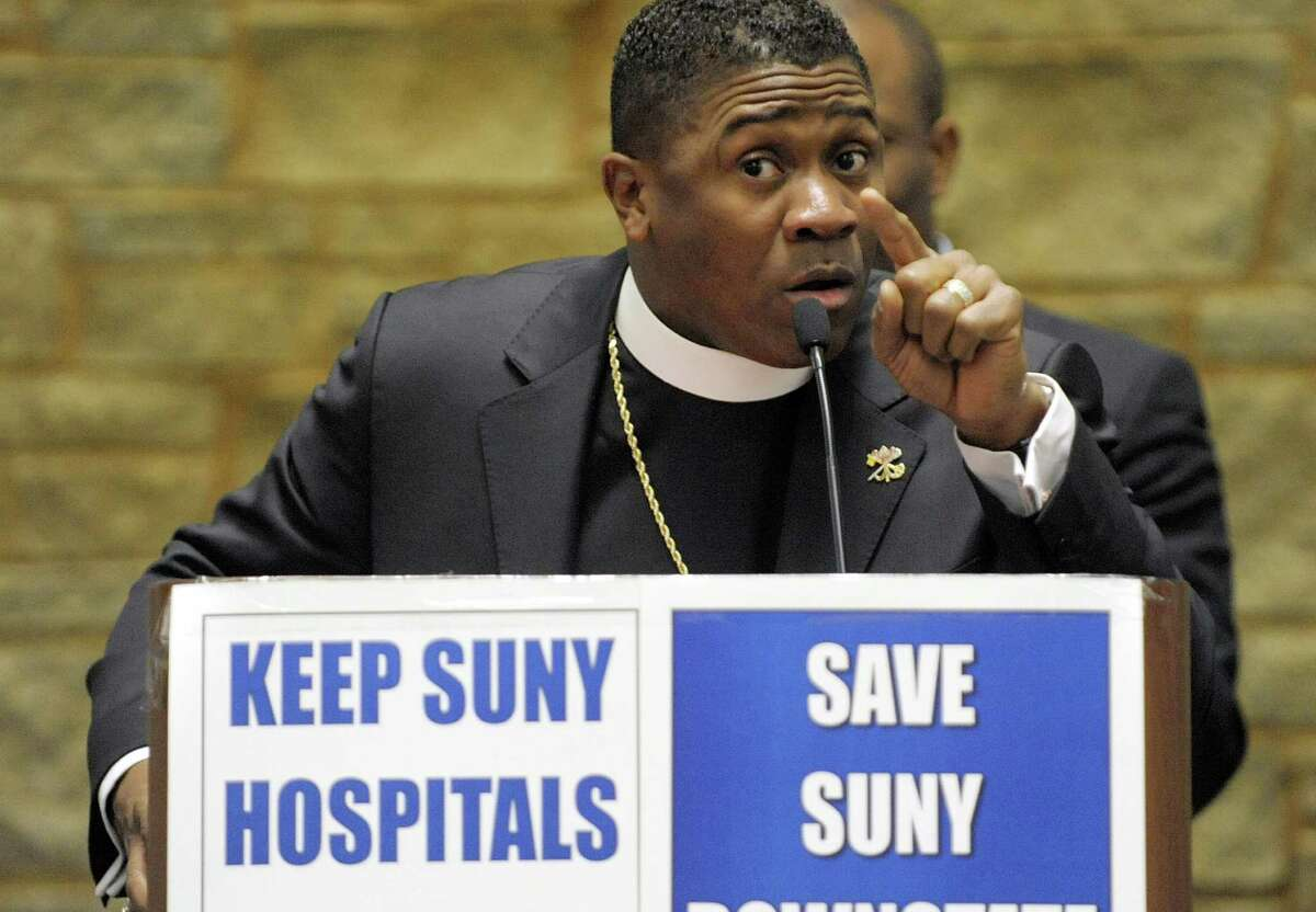 Bishop Eric Garnes with the Tabernacle of Praise Cathedral in Brooklyn addresses those gathered for a rally at the Legislative Office Building on Tuesday, Jan. 8, 2013 in Albany, NY. Members of various unions along with leaders and members of community faith organizations and churches held the rally to show support for workers at SUNY's three public hospitals. Organizers of the rally say that thousands of jobs at the SUNY Downstate Medical Center's University Hospital of Brooklyn are to be eliminated as part of a financial restructuring. Organizers also say that their is talk of reducing services at the other SUNY hospitals as well. (Paul Buckowski / Times Union)