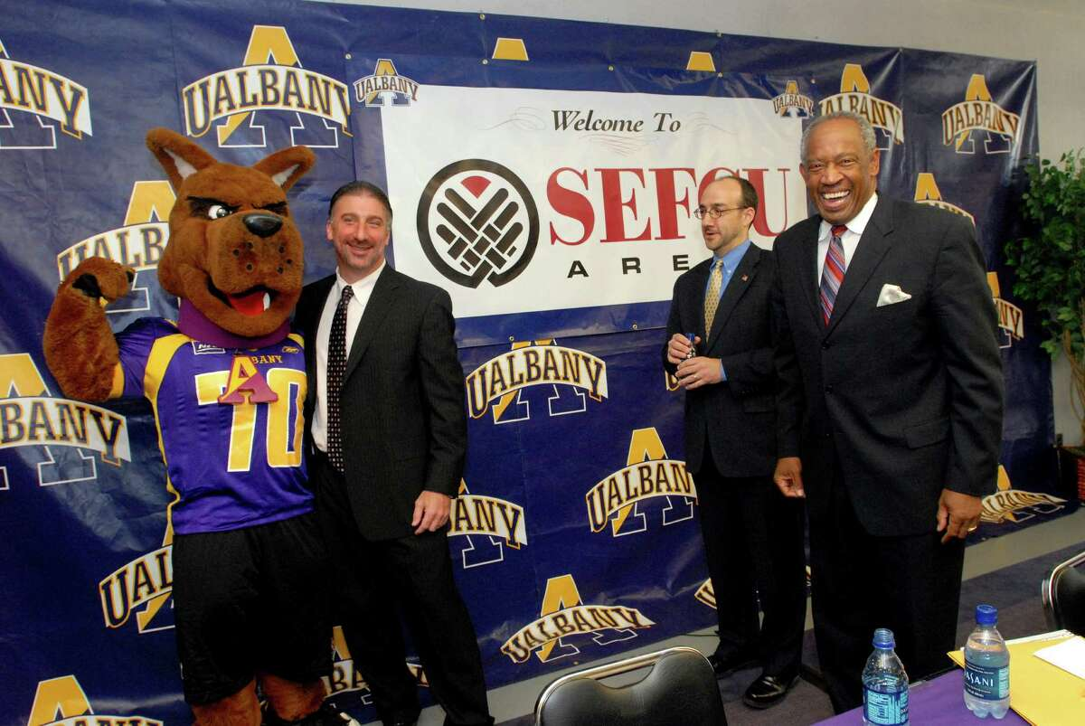 Times Union staff photo by Cindy Schultz -- Michael Castellana, president of SEFCU, left, poses with UAlbany's Great Dane, following a news conference to announce the newly named SEFCU Arena on Wednesday, Nov. 1, 2006, at UAlbany in Albany, N.Y. Joining them are UAlbany vice president athletic director Lee McElroy, right, and Robert Bellafiore, SUNY trustee, second from right. (WITH SINGLAIS STORY)
