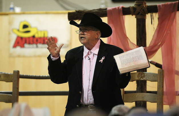 Evangelist J.D. Dunson of Weatherford delivers the sermon, a defense of the Bible's authenticity, in the auction barn.