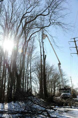 Trees are trimmed along the railroad tracks in Stamford on Thursday, February 14, 2013, to prevent outages on the New Haven Line. Photo: Lindsay Perry / Stamford Advocate