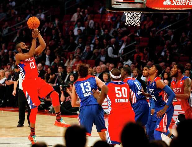 James Harden of the Houston Rockets (13) puts up a shot during the first half. Photo: James Nielsen / © 2013  Houston Chronicle