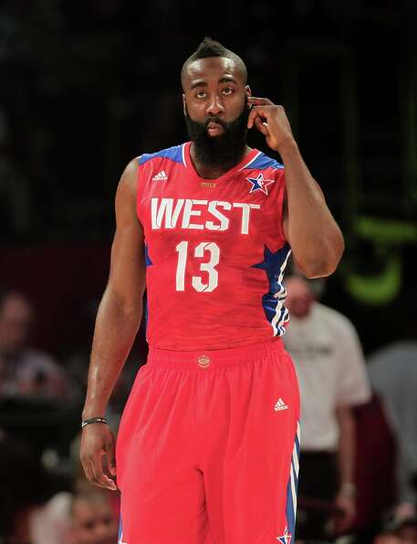 James Harden of the Houston Rockets (13) takes the floor after a timeout during the first half.