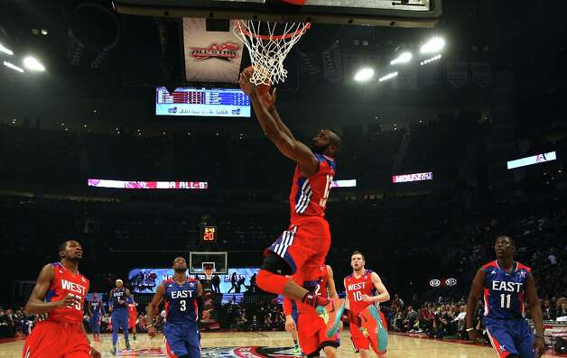 James Harden of the Houston Rockets (13) drives to the basket during the first half. Photo: James Nielsen / © 2013  Houston Chronicle