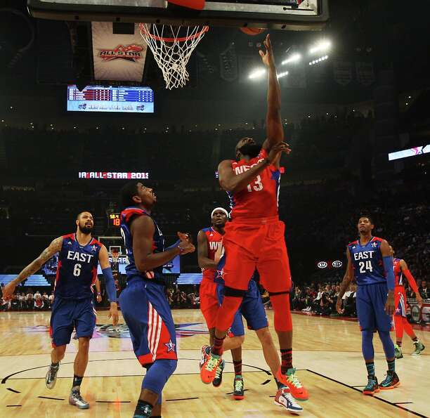 James Harden of the Houston Rockets (13) goes for a layup during the first half.