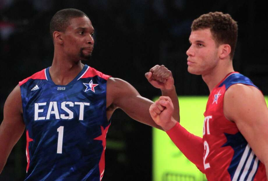 Chris Bosh of the Miami Heat (1) and Blake Griffin of the Los Angeles Clippers (32) greet at mid court before the NBA All-Star Game. Photo: James Nielsen / © 2013  Houston Chronicle