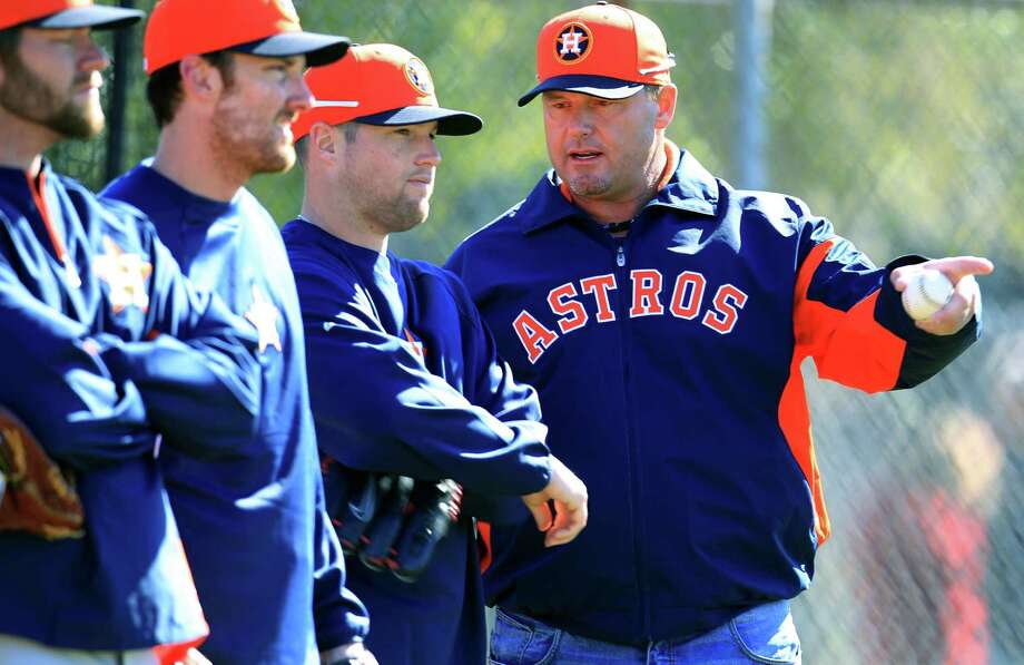 Special guest instructor Roger Clemens, right, has the ear of Bud Norris, who could be in line to be the opening-day starter, something Clemens was many times in his career but never with the Astros. Photo: Karen Warren, MBI / Houston Chronicle