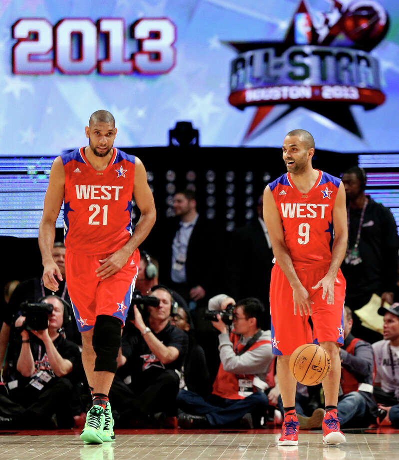 West's Tim Duncan and Tony Parker head up court against the East during first half action of the 62nd All-Star game at the Toyota Center Sunday Feb. 17, 2013 in Houston. Photo: Edward A. Ornelas, San Antonio Express-News / © 2013 San Antonio Express-News