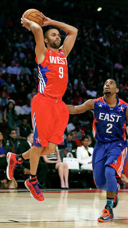 West's Tony Parker passes over East's Kyrie Irving during first half action of the 62nd All-Star game at the Toyota Center Sunday Feb. 17, 2013 in Houston. Photo: Edward A. Ornelas, San Antonio Express-News / © 2013 San Antonio Express-News