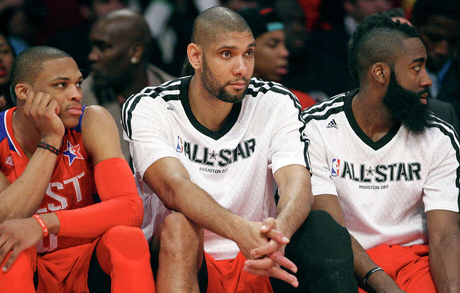 West's Russell Westbrook (from left), Tim Duncan, and James Harden watch action first half action against the East from the bench during the 62nd All-Star game at the Toyota Center Sunday Feb. 17, 2013 in Houston. Photo: Edward A. Ornelas, San Antonio Express-News / © 2013 San Antonio Express-News