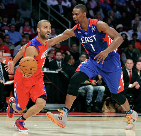 West's Tony Parker looks for room around East's Chris Bosh during first half action of the 62nd All-Star game at the Toyota Center Sunday Feb. 17, 2013 in Houston. Photo: Edward A. Ornelas, San Antonio Express-News / © 2013 San Antonio Express-News